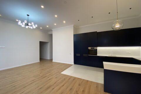 dark blue kitchen with chandelier