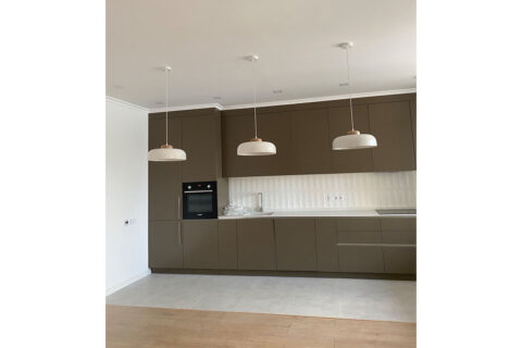 brown kitchen and three lamps