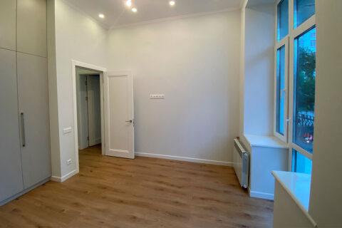 white room with wardrobe and balcony