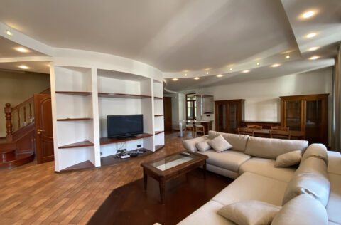 large living room with grey sofa