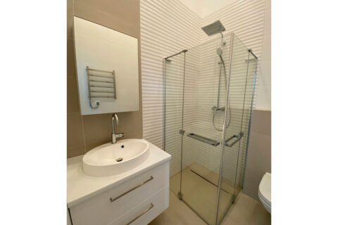 white bathroom with shwer cabin