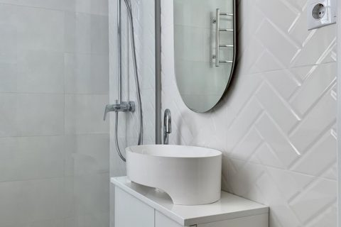 white bathroom with a shower