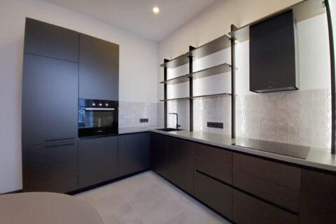 dark kitchen with all appliance