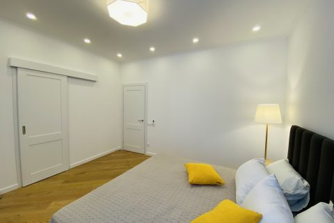 bedroom with a yellow pillows